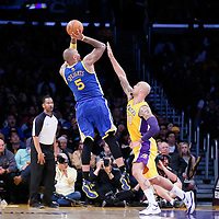 11 April 2014: Golden State Warriors forward Marreese Speights (5) takes a jump shot over Los Angeles Lakers center Robert Sacre (50) during the Golden State Warriors 112-95 victory over the Los Angeles Lakers at the Staples Center, Los Angeles, California, USA.