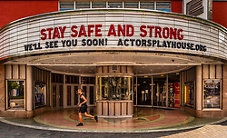 A jogger runs past the Miracle theater, home to the Actors Playhouse, on the Miracle Mile in Coral Gables. Miami Dade County was under a shelter in place order on March 26.