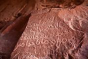 Nabatean petroglyph inscriptions in Khazali Canyon, Wadi Rum, Jordan.