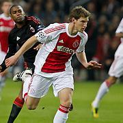 NLD/Amsterdam/20100928 - Champions Leaguewedstrijd Ajax - AC Milan, Robinho in duel met Toby Alderweireld