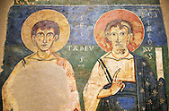 Ager Apostles: James and Thaddeus<br /> <br /> Late XI - XII century<br /> Fresco transferred to canvas from the Church of St. Peter Anger, Noguera, Spain.<br /> <br /> Acquisition of Museums Board's campaign in 1958. MNAC 65467<br /> <br /> Romanesque fresco ascribed to the so-called Pedret Painters of Ager.  Typical of this school is the composition or refinement in the modeling of faces with characteristic forehead, cheeks and neck, which show the quality of Painters. San Ager was one of the main centers of religious and political centres in the south of Urgell. .<br /> <br /> If you prefer you can also buy from our ALAMY PHOTO LIBRARY  Collection visit : https://www.alamy.com/portfolio/paul-williams-funkystock/romanesque-art-antiquities.html<br /> Type -     MNAC     - into the LOWER SEARCH WITHIN GALLERY box. Refine search by adding background colour, place, subject etc<br /> <br /> Visit our ROMANESQUE ART PHOTO COLLECTION for more   photos  to download or buy as prints https://funkystock.photoshelter.com/gallery-collection/Medieval-Romanesque-Art-Antiquities-Historic-Sites-Pictures-Images-of/C0000uYGQT94tY_Y