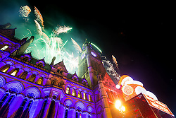 © Licensed to London News Pictures . 01/01/2016 . Manchester , UK . Manchester celebrates the start of the New Year with a fireworks display in front of the Town Hall in Albert Square . Photo credit : Joel Goodman/LNP