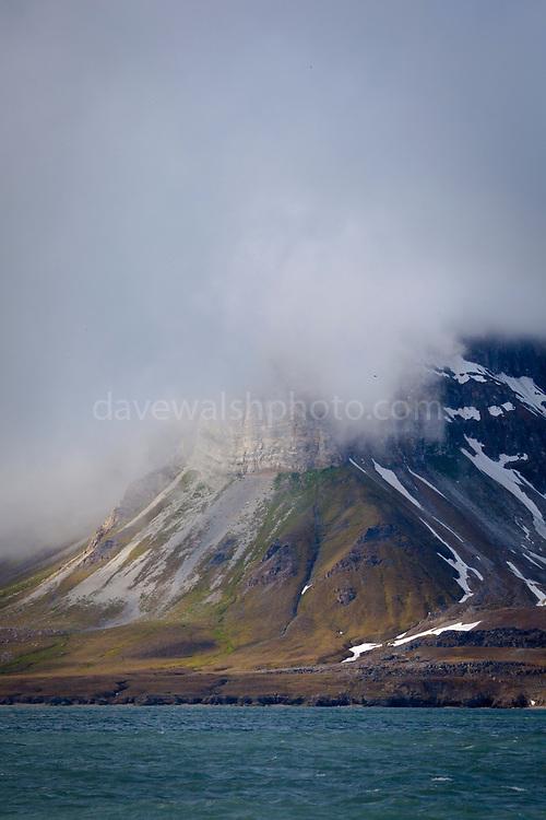 A cloud caps a mountain on the Isjforden, Svalbard