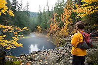 Young man hiking along the Upper McKenzie River  OR.