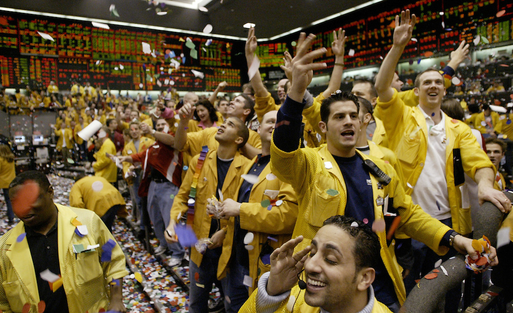 Clerks and traders in the Eurodollar pit at the Chicago Mercantile Exchange celebrate the close of the trading year with a shower of confett.