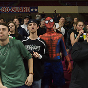 Wyoming East students watch a free throw during the WVSSAC Class AA North Marion-Wyoming East girls basketball state championship at the Civic Center in Charleston, W.V., on Saturday, March 10, 2018.