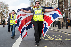 London, UK. 30th March, 2019. Pro-Brexit activists from Yellow Vests UK march in Whitehall during an event billed as the Great British Betrayal Rally.