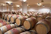 barrel aging cellar chateau lestrille bordeaux france
