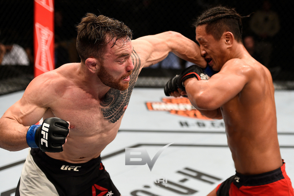 LAS VEGAS, NV - DECEMBER 03:  (L-R) Brendan O'Reilly of Australia punches Dong Hyun Kim of South Korea in their lightweight bout during The Ultimate Fighter Finale event inside the Pearl concert theater at the Palms Resort & Casino on December 3, 2016 in Las Vegas, Nevada. (Photo by Jeff Bottari/Zuffa LLC/Zuffa LLC via Getty Images)