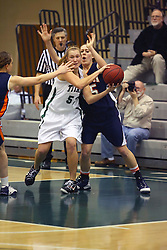 10 January 2009: With Jamie Jones on her back, Stacey Arlis makes a pass. The Lady Titans of Illinois Wesleyan University downed the and Lady Thunder of Wheaton College by a score of 101 - 57 in the Shirk Center on the Illinois Wesleyan Campus in Bloomington Illinois.