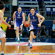 Fenerbahce Ulker's Jan Vesely (R) and Anadolu Efes's Cedi Osman (C) during their Turkish Basketball League match Fenerbahce Ulker between Anadolu Efes at the Ulker Sports Arena in Istanbul, Turkey, Sunday 26 April, 2015. Photo by Aykut AKICI/TURKPIX