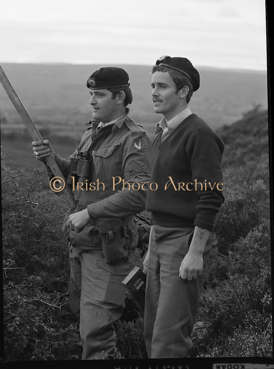 """Army Exercises In Co Sligo.   (L37).<br /> 1977.<br /> 05.09.1977.<br /> 09.05.1977.<br /> 5th September 1977.<br /> The Army Reserve Brigade, which is made up of regular units from the Southern Command, are conducting a series of conventional military exercises in counties Mayo and Sligo from the 5th to the 9th September. Approximately 1,500 men and 250 vehicles are involved. The exercise was codenamed """"Humbert"""" after an ill fated expedition by French troops into Ireland on 23rd August 1798. 1,100 French troops with Irish support took on the incumbent English forces. After some initial success they were defeated at Ballinamuk on 8th Sept 1798 by the army of Cornwallis.<br /> <br /> Image of Corp Michael Ginks and Pte Noel Whelan placing the flag to be 'captured'."""