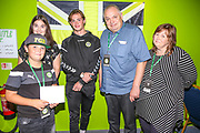 Forest Green Rovers Theo Archibald(18) with the match sponsors during the EFL Sky Bet League 2 match between Forest Green Rovers and Stevenage at the New Lawn, Forest Green, United Kingdom on 21 August 2018.