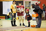 Middletown, New York  - A young girl in a pirate costume plays a game in the gymnasium during the Middletown YMCA Family Fall Festival on Oct. 29, 2011. ©Tom Bushey / The Image Works