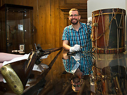 Pictured: Curator Nico Tyack examines handcuffs from the 18th century <br /> <br /> The latest Museum of Edinburgh exhibition documents the history of Edinburgh's Town Guard, which brought law and order to the city in the 18th century. Curator Nico Tyack and Museum Assistant David Mclay examined muskets, halberds and drums before the exhibition was opened to the public<br /> <br /> Ger Harley   EEm 15 June 2017
