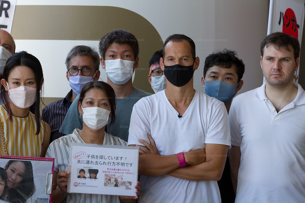 Day seven of Frenchman, Vincent Fichot's (Centre with black mask) hunger strike outside Sendagaya Station, Tokyo, Japan. Saturday July 17th 2021. Vincent Fichot has not seen his two children since they were abducted by his wife in 2018. He started a hunger strike to put pressure on French President, Emmanuel Macron, who will be attending the 2020 Tokyo Olympic opening ceremony, to raise the issue further with the Japanese government.