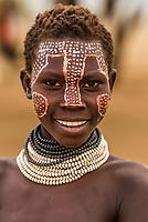 Happy teenaged Kara tribe girl, Omo Valley, Ethiopia.
