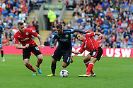 Yohan Cabaye of Newcastle Utd © goes past Cardiff's Aron Gunnarsson and Peter Odemwingie ®. Barclays Premier League match, Cardiff city v Newcastle Utd  at the Cardiff city stadium in Cardiff, South Wales on Saturday 5th Oct 2013. pic by Andrew Orchard, Andrew Orchard sports photography,