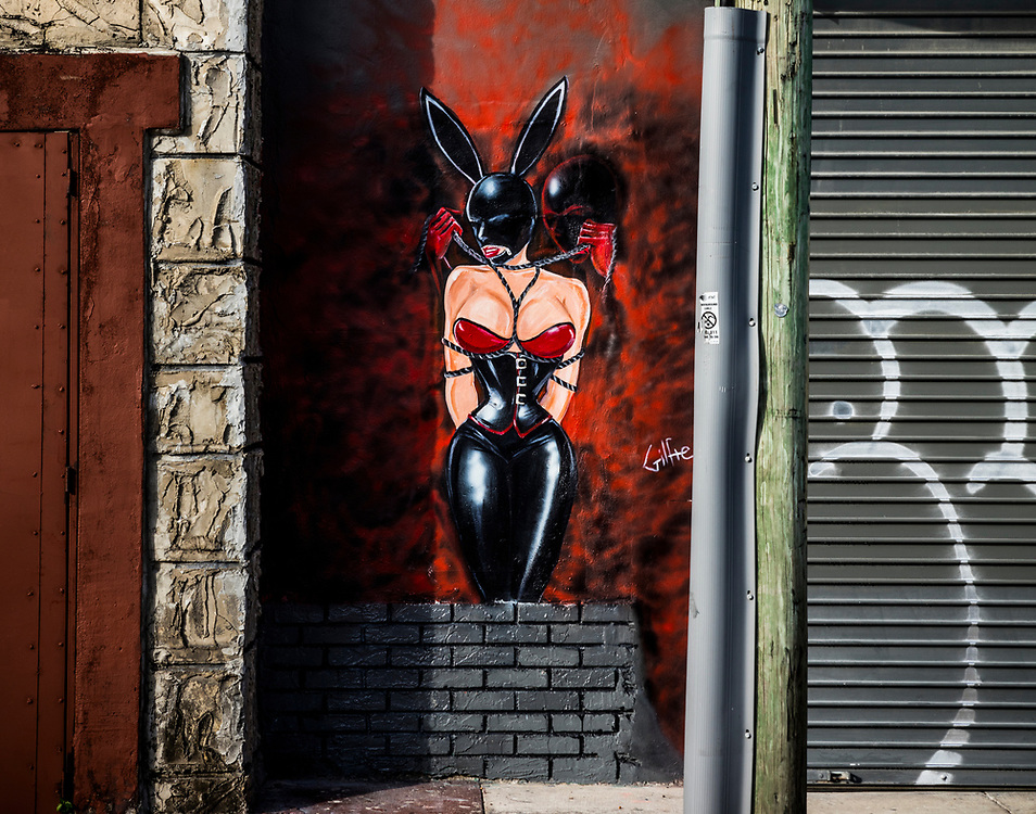 A kinky bondage scene painted on a wall in Miami's Wynwood Arts District, home to hundreds of diverse street murals.