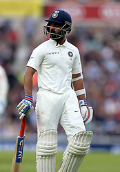 India's Ajinkya Rahane walks of the field after being caught by England's Alastair Cook (not in picture) during the test match at The Kia Oval, London.