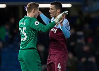 Football - 2019 / 2020 Premier League - Chelsea vs. West Ham United<br /> <br /> Fabian Balbuena (West Ham United) congratulates David Martin (West Ham United) after his performance  at Stamford Bridge <br /> <br /> COLORSPORT/DANIEL BEARHAM