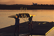 Sydney, AUSTRALIA, Crew carrying their boat on the boating dock to take part in an early morning training session, at the 2000 Olympic Regatta, Penrith Lakes. [Photo Peter Spurrier/Intersport Images] 2000 Olympic Rowing Regatta00085138.tif