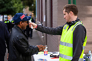 A man is seen having his temperature checked before entering the main staging area outside of the remaining locked down tower at Alfred Street during COVID-19 on 10 July, 2020 in Melbourne, Australia. Former Federal Labor Leader Bill Shorten, along with close allies at Trades Hall help deliver Halal meat, supplied by Macca Halal Foods to the locked down housing commission towers following a coronavirus outbreak detected inside the complex. Mr Shorten was able to use his high profile to ensure food was not turned away by police so that it would reach the residents inside. (Photo be Dave Hewison/ Speed Media)