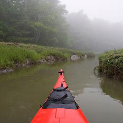 Kayaking a tidal creek in Marquoit Bay, Brunswick, Maine.