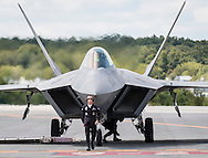 New Windsor, New York - A member of the flight crew directs a U.S. Air Force F-22 Raptor on the runway after a flight during a practice session for the New York Air Show at Stewart International Airport on Aug. 28, 2015.