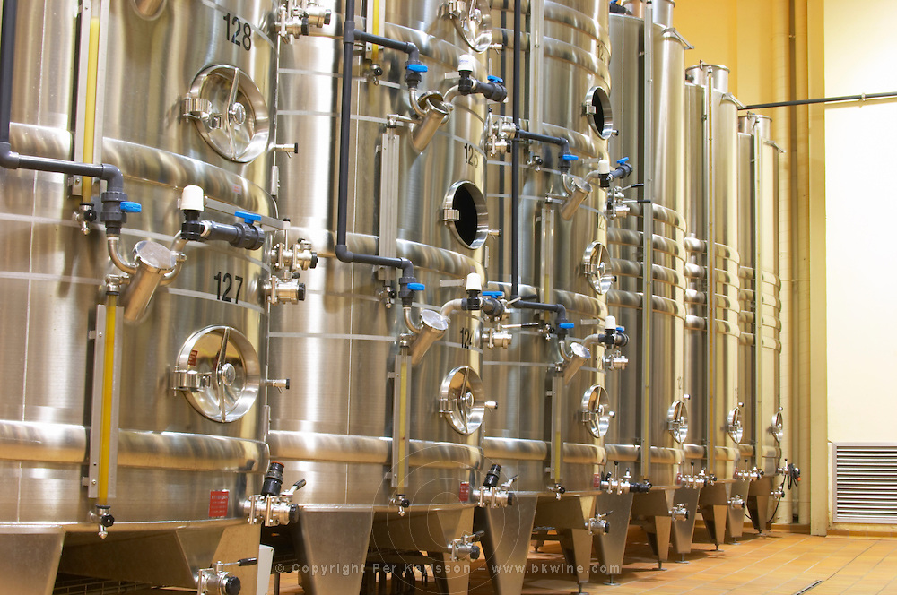 Stacks of stainless steel fermentation vats in various sizes and with cooling systems, Maison Louis Jadot, Beaune Côte Cote d Or Bourgogne Burgundy Burgundian France French Europe European