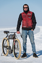 Alexander Propovednik with the bicycle he raced in the Baikal Mile Ice Speed Festival. Maksimiha, Siberia, Russia. Friday, February 28, 2020. Photography ©2020 Michael Lichter.