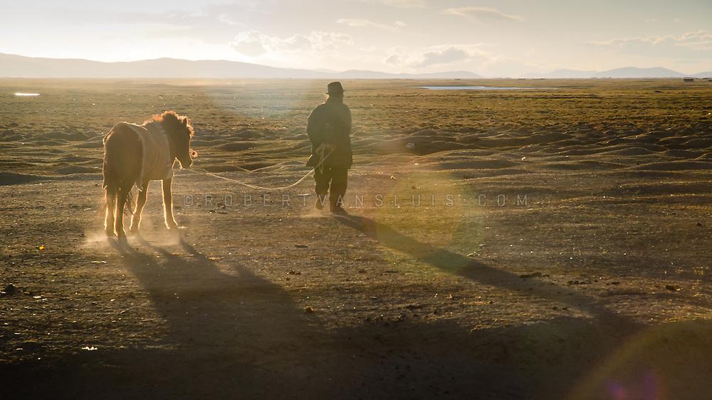 Farmer with his horse at sunset, near Paryang, Tibet. Photo © Robert van Sluis - www. robertvansluis.com