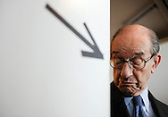 Former Federal Reserve Chairman Alan Greenspan stands at a doorway as he waits to go onstage for an interview at the Newseum in Washington.