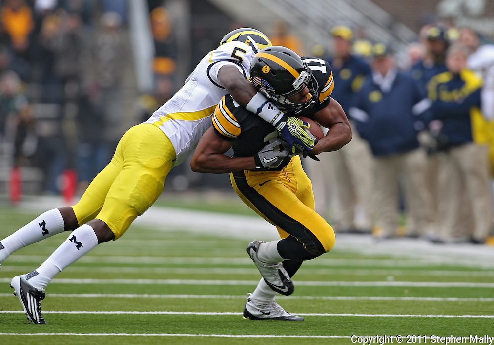 November 05, 2011: Iowa Hawkeyes wide receiver Kevonte Martin-Manley (11) is hit by Michigan Wolverines cornerback Courtney Avery (5) during the second quarter of the NCAA football game between the Michigan Wolverines and the Iowa Hawkeyes at Kinnick Stadium in Iowa City, Iowa on Saturday, November 5, 2011. Iowa defeated Michigan 24-16.