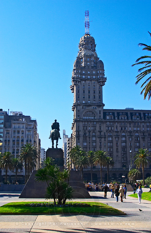The Salvo Palace building on Plaza Independencia Independence Square, the most imposing building in Montevideo. With the mausoleum of General Jose Artigas with equestrian statue on the square. Montevideo, Uruguay, South America