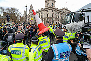 A traffic cone was thrown at the police as they pushed protesters away while scuffling and arguing with demonstrators during clashes following a 'Kill the Bill' protest outside the Houses of Parliament in London on Saturday, April 3, 2021. <br /> Dozens of extra officers were brought in to help unblock the road for a McDonald's lorry held up outside parliament. (Photo/ Vudi Xhymshiti)