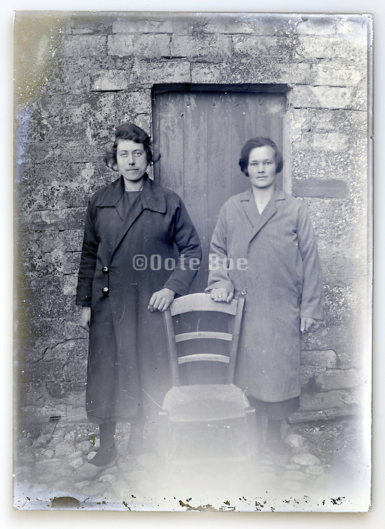 eroding glass plate with two women