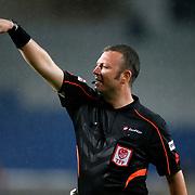 Referee's Tolga Ozkalfa (C) during their Turkish Super League soccer match Istanbul Basaksehir between Galatasaray at the Basaksehir Fatih Terim Arena at Basaksehir in Istanbul Turkey on Sunday, 26 October 2014. Photo by Aykut AKICI/TURKPIX