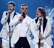 Editorial use only. No book publishing<br /> Mandatory Credit: Photo by Dymond/Thames/Syco/Shutterstock (10010245bs)<br /> Take That - Robbie Williams and Mark Owen<br /> 'The X Factor' TV show, Final, Series 15, Episode 27, London, UK - 02 Dec 2018