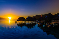 Overwater bungalows at sunrise, Hilton Moorea Lagoon Resort, island of Moorea, French Polynesia.