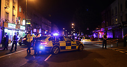 """Police man a cordon at Finsbury Park in north London, where one person has been arrested after a vehicle struck pedestrians, leaving """"a number of casualties""""."""
