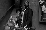 Shandre Annikey, sits outside of his apartment with his Son Xzavier,2, in Spring Valley on Wednesday, March 3, 2021.  Annikey a sailor battling cancer, is facing court-martial on assault and marijuana charges after allegedly assaulting officers who came to arrest him for marijuana possession in his hospital bed.(Photo by Sandy Huffaker for The San Diego Union-Tribune)