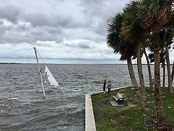October 7, 2016 - Florida, U.S. - Residents check out a sunken sailboat along the Jenson Causeway in Jensen Beach on Friday morning. (Credit Image: © Richard Graulich/The Palm Beach Post via ZUMA Wire)