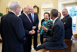 President Barack Obama visits with stakeholders after he signs the America's Promise Summit Declaration in the Oval Office, Sept. 22, 2014. Attendees from left: Harris Wofford, former U.S. Senator; Gen. Colin L. Powell, founding Chair, America's Promise Alliance; Gregg Petersmeyer, Vice-Chair, America's Promise Alliance; Alma Powell, Chair, America's Promise Alliance and John Gomperts, President and CEO, America's Promise Alliance. (Official White House Photo by Pete Souza)<br /> <br /> This official White House photograph is being made available only for publication by news organizations and/or for personal use printing by the subject(s) of the photograph. The photograph may not be manipulated in any way and may not be used in commercial or political materials, advertisements, emails, products, promotions that in any way suggests approval or endorsement of the President, the First Family, or the White House.