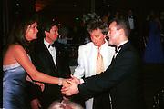 Rachel Hunter, Rod Stewart and Paul Burrell. The Princess Ball. Beverly Wilshire Hotel. Beverly Hills. 21 March 1998. © Copyright Photograph by Dafydd Jones 66 Stockwell Park Rd. London SW9 0DA Tel 020 7733 0108 www.dafjones.com