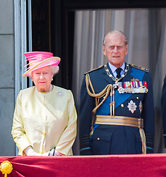 Queen Elizabeth ll, Prince William and Prince Philip, Duke of Edinburgh stand on the balcony of Buckingham Palace in London to watch a fly past to commemorate the 75th anniversary of The Battle of Britain on July 10, 2015.