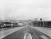 "Ackroyd 02600-10 ""Standard Oil. New sign location"" December 29, 1950"" looking west across the Burnside Bridge, camera location is in a traffic divider in the middle of the bridge, between the lanes. White Satin Sugar sign"