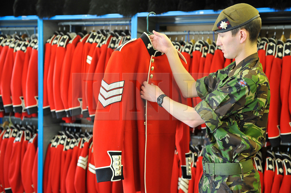 © licensed to London News Pictures. Windsor, UK  21/04/2011. The Irish Guards at Victoria Barracks, Windsor prepare for the Royal Wedding in a weeks time on 29th April 2011. The Commanding Officer Chris Ghika gave a parade of inspection with the Irish Guards Master Tailor Lance Sergeant Matthew Else. Afterwards the Master Tailor measured the guards for their ceremonial dress unifirorms which they will wear on the wedding day.Please see special instructions for usage rates. Photo credit should read Theodore Wood/LNP