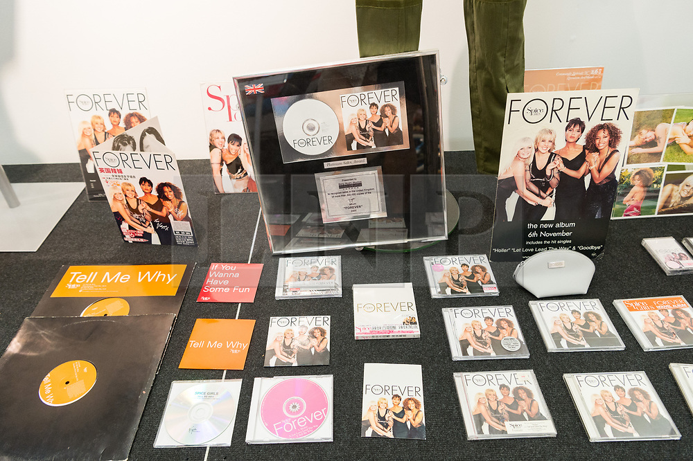 © Licensed to London News Pictures. 26/07/2018. London, UK. A selection Spice Girls music cd's and album material featuring Mel B, Melanie C, Geri Halliwell, Victoria Beckham, Emma Bunton are on display at the Spice Girls exhibition. The interactive exhibition features hundreds of iconic stage, music video and film costumes worn by the popular 90s girl band at Business Design Centre/Photo credit: Ray Tang/LNP