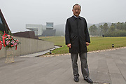 Lu Jun, the financial backer of the Sifang Art Museum and the larger China International Practical Exhibition of Architecture (CIPEA), stands for a photograph before the opening of the Sifang Art Museum in Nanjing, Jiangsu Province, China on 02 November, 2013.